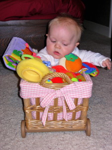 Max Bailey sitting supported in a basket.